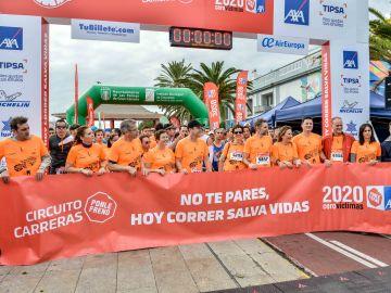 Personalidades y representantes de las entidades beneficiarias, minutos antes pistoletazo de salida de la Carrera Ponle Freno Las Palmas de Gran Canaria