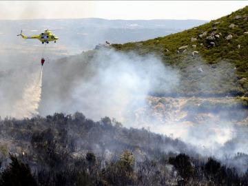 Extinción del fuego en Oímbra, Ourense, en junio