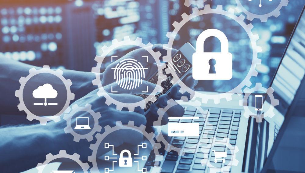 Sobre un portátil aparecen iconos relacionados con la seguridad